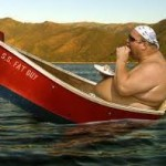 fat guy in canoe